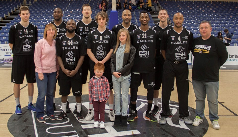 Champion Shannon Hiscock and her family with Newcastle Eagles players!